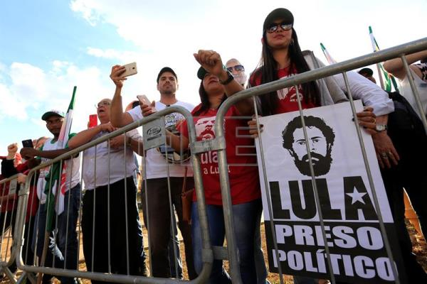 Millions of Brazilians - now including the Communist Party - continue to back former center-left President Luiz Inacio Lula da Silva, though he remains behind bars on a corruption conviction that is likely to keep his name off the Oct. 7 ballot. EFE/Joedson Alves/File