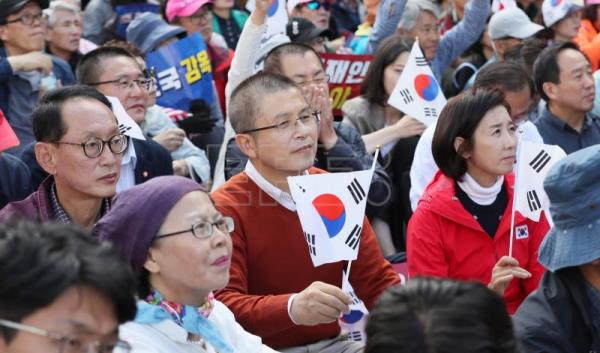 Protesters in Seoul demand President Moon's resignation after corruption row
