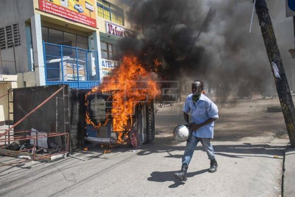 Demonstrators burn a truck during a march against corruption and impunity, in Port-au-Prince, Haiti, 17 October 2018. Thousands of Haitians took to the streets of the capital and other parts of the country to demand that those responsible for the alleged corruption that occurred around the funds of the Petrocaribe program be brought before the courts. The today demonstration was the largest held in Port-au-Prince since the beginning of the anti-corruption movement several months ago. EPA-EFE/FILE/JEAN MARC HERVE ABELARD