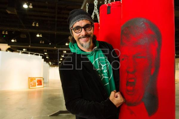 "Photo provided on Jan. 10, 2018 shows Cuban artist Antuan Rodriguez posing next to his exhibit Izquierda o derecha"" (Left or right), at the Los Angeles Art Show, in Los Angeles, United States on Jan. 9, 2018. EPA-EFE/Felipe Chacon"
