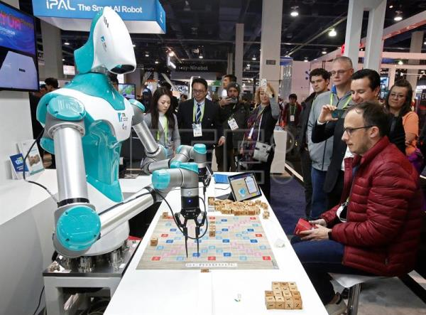A man plays a game with a robot from ITRI, Industrial Technology Research Institute on opening day at the 2018 International Consumer Electronics Show in Las Vegas, Nevada, USA, Jan. 9, 2018. EPA-EFE/LARRY W. SMITH