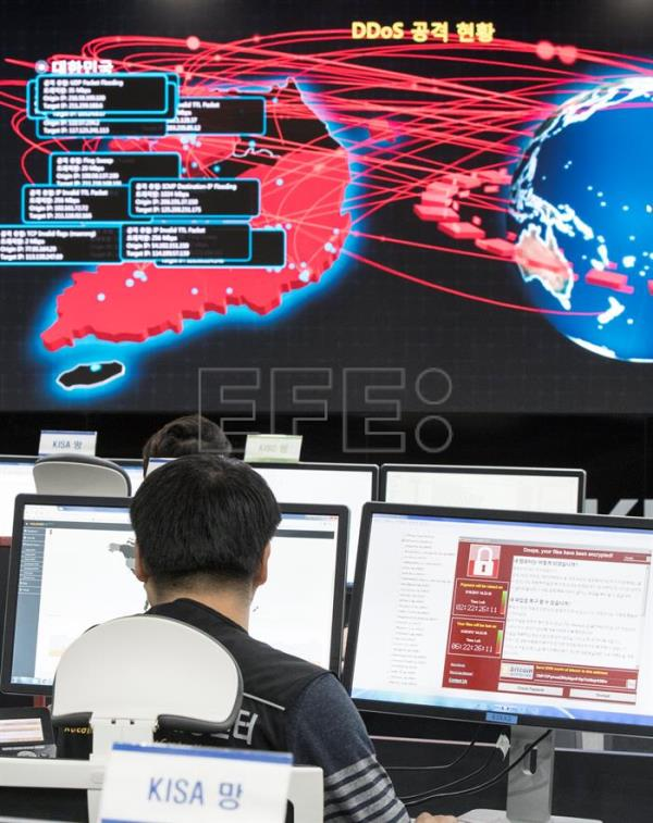 (FILE) Employees watch an electronic board to monitor possible ransomware cyberattacks at the Korea Internet and Security Agency (KISA) in Seoul, South Korea, 15 May 2017. EPA/YONHAP SOUTH KOREA OUT