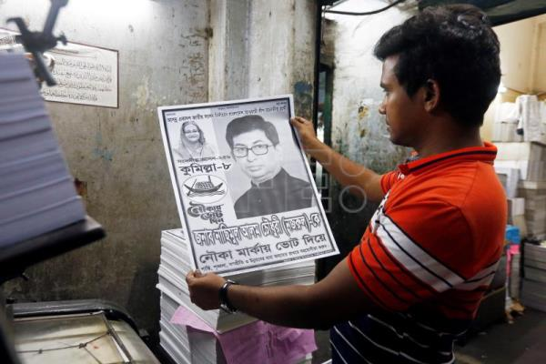 Bangladeshi workers print campaigning posters and leaflets of the political leaders and their parties ahead of the parliamentary elections, in Dhaka, Bangladesh, Dec. 10, 2018. EPA-EFE/MONIRUL ALAM