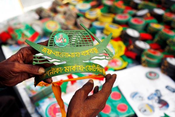 Bangladeshi street vendor sells campaign materials in Dhaka city, Bangladesh, Dec. 3, 2018. EPA-EFE FILE/MONIRUL ALAM