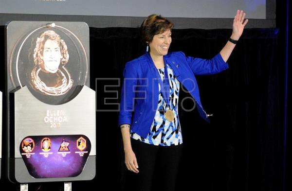 Astronaut Ellen Ochoa waves to the audience during the induction ceremony for the Astronauts' Hall of Fame at the Kennedy Space Center in Port Canaveral, Florida, USA, May 19, 2017. EFE/GERARDO MORA