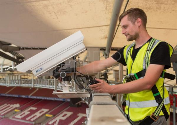 A file picture shows Florian Widmaier, Football Systems Engineer with Hawk-Eye Innovations, installing a Hawk-Eye camera at at the Mercedes-Benz Arena in Stuttgart, Germany, Jul. 23, 2015. EPA/MARIJAN MURAT GERMANY OUT