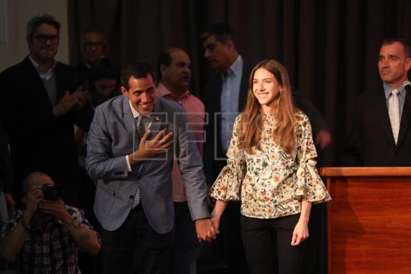 Venezuela's self-proclaimed interim president, Juan Guaido (l.), appears with wife Fabiana Rosales (r.) at an event in Caracas on Feb. 8, 2019, where he said that if the Nicolas Maduro government blocks food and medicines donated by other nations from entering the country, a volunteer force will head for the borders to open a humanitarian corridor. EFE-EPA/Miguel Gutierrez