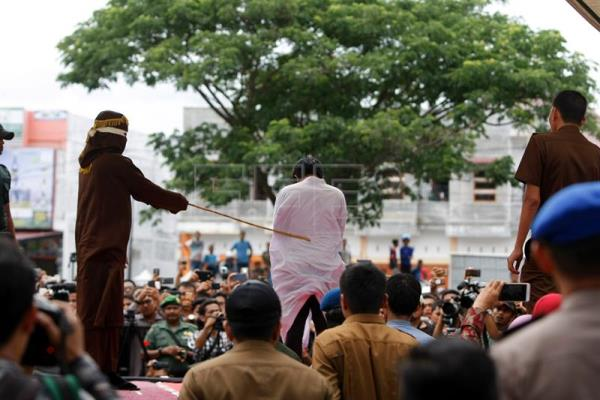 A man is whipped in front of the public as punishment for being in a same-sex relationship in Banda Aceh, Indonesia, May 23, 2017. EPA-EFE FILE/HOTLI SIMANJUNTAK
