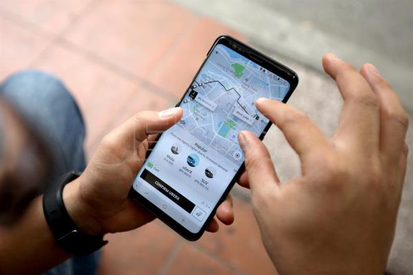 Singapore to probe Grab-Uber merger over competition law breach