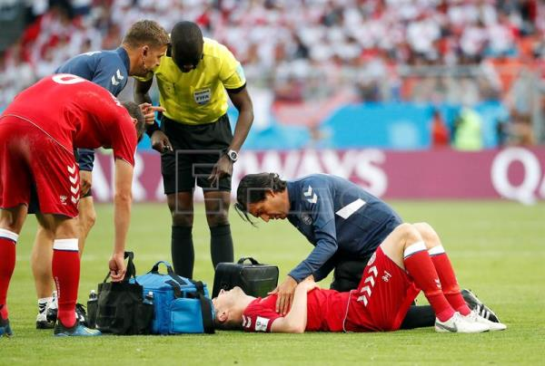 Denmark's William Kvist (down) gets medical assistance during the FIFA  World Cup 2018 Group