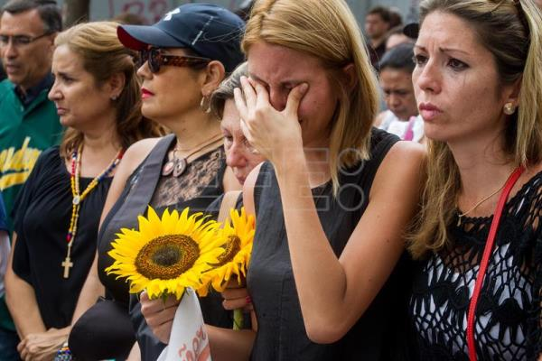 Venezuelan opposition marches in memory of young man killed at protest