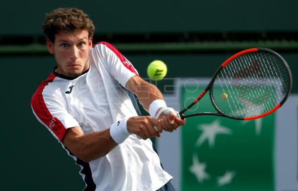 Pablo Carreno Busta from Spain in action against Daniil Medvedev from Russia during the BNP Paribas Open at the Indian Wells Tennis Garden in Indian Wells, California, USA, Mar. 12, 2018. EPA-EFE/MIKE NELSON
