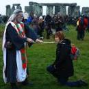 Revelers take part in winter solstice celebrations at the ancient Stonehenge monument in Wiltshire, United Kingdom, Dec. 22, 2017. EPA/NEIL HALL