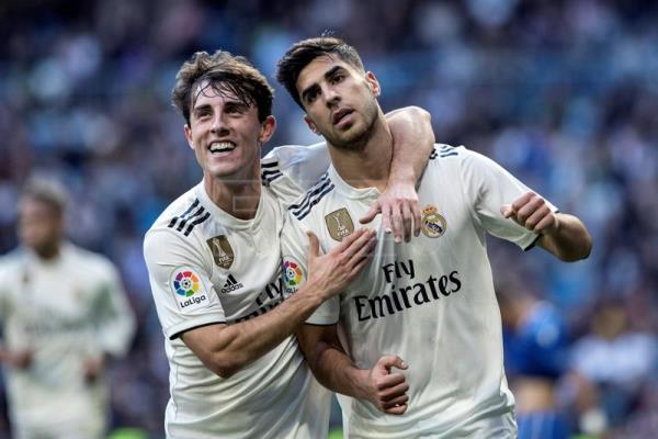 Real Madrid's midfielder Marco Asensio (R) celebrates with his teammate Alvaro Odriozola after scoring the 1-0 lead during a Spanish King's Cup round of 32 second leg match between Real Madrid and Melilla at the Santiago Bernabeu stadium, in Madrid, Spain, Dec. 06, 2018. EFE-EPA/RODRIGO JIMENEZ