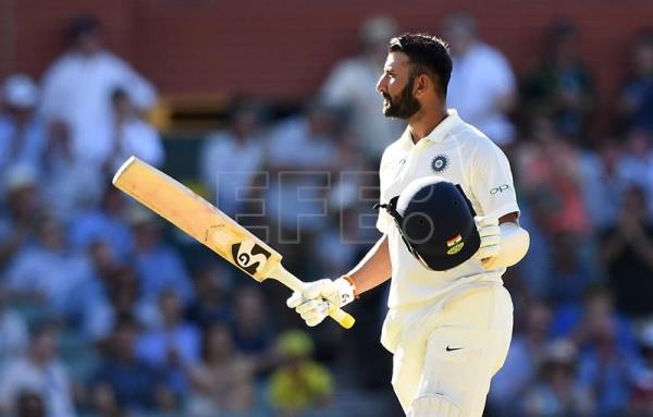 Indian batsman Cheteshwar Pujara looks on after reaching his century on day one of the first Test match between Australia and Indiain Adelaide, Australia, Dec. 6, 2018. EPA-EFE/DAVE HUNT/NO ARCHIVING, EDITORIAL USE ONLY, IMAGES TO BE USED FOR NEWS REPORTING PURPOSES ONLY, NO COMMERCIAL USE WHATSOEVER, NO USE IN BOOKS WITHOUT PRIOR WRITTEN CONSENT FROM AAP AUSTRALIA AND NEW ZEALAND OUT