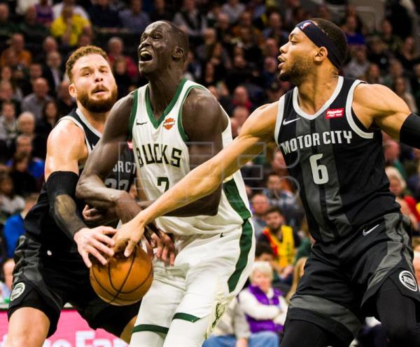 Milwaukee Bucks forward Thon Maker (C) of Australia loses the ball between Detroit Pistons forward Blake Griffin (L) and Detroit Pistons guard Bruce Brown (R) during the NBA basketball game between the Detroit Pistons and the Milwaukee Bucks at Fiserv Forum in Milwaukee, Wisconsin, USA, Dec. 05, 2018. EPA-EFE/TANNEN MAURY SHUTTERSTOCK OUT