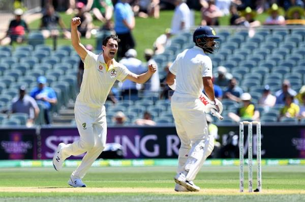 Australian bowler Pat Cummins (L) reacts after dismissing Indian batsman Virat Kohli (R) for three runs during day one of the first Test match between Australia and India in Adelaide, Australia, Dec. 6, 2018. EPA-EFE/DAVE HUNT/NO ARCHIVING, EDITORIAL USE ONLY, IMAGES TO BE USED FOR NEWS REPORTING PURPOSES ONLY, NO COMMERCIAL USE WHATSOEVER, NO USE IN BOOKS WITHOUT PRIOR WRITTEN CONSENT FROM AAP AUSTRALIA AND NEW ZEALAND OUT