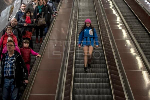 A woman wearing no pants participates in the 'No Pants Subway Ride' in Prague, Czech Republic, Jan. 7, 2018. EPA-EFE/MARTIN DIVISEK