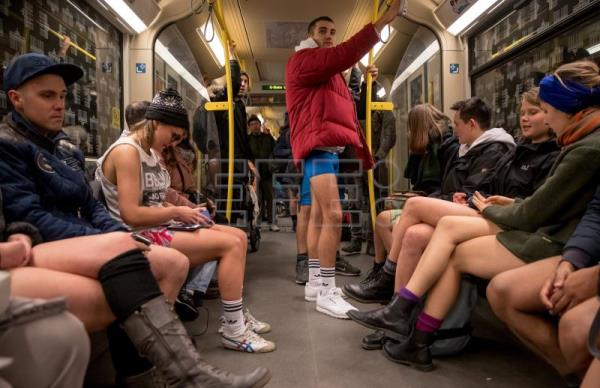 People wearing no pants participate in the worldwide event 'No Pants Subway Ride' in Berlin, Germany, Jan. 7, 2018. EPA-EFE/HAYOUNG JEON