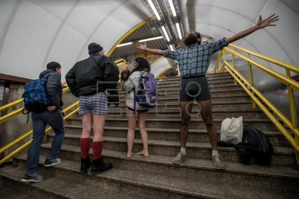 People wearing no pants participate in the 'No Pants Subway Ride' in Prague, Czech Republic, Jan. 7, 2018. EPA-EFE/MARTIN DIVISEK