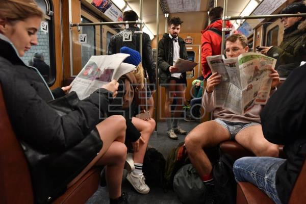 A group of people wearing only underpants ride in the subway during the 'No Pants Subway Ride' in central Munich, Germany, Jan. 7, 2018. EPA-EFE/JOERG KOCH