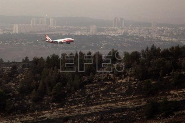 Israel wildfires brought under control, police spokesman says