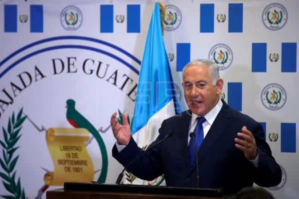 Israeli Prime Minister Benjamin Netanyahu gestures as he speaks during the dedication ceremony of the embassy of Guatemala in Jerusalem, May 16, 2018. EPA/RONEN ZVULUN