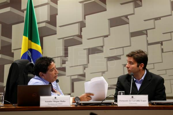 Photograph showing former coach of the Brazilian men's gymnastics team, Fernando de Carvalho Lopes (r), before a Senate committee in Brasilia, Brazil, May 16, 2018. EPA-EFE/Joedson Alves