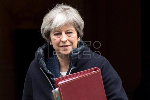 British Prime Minister Theresa May leaves Downing Street to attend Prime Minister Questions in the House of Commons, Central London, UK, Mar. 7, 2018. EPA-EFE FILE/WILL OLIVER