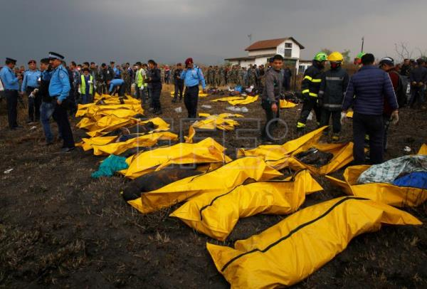 Dead bodies recovered from the wreckage of a plane that crashed at the main airport Tribhuvan International Airport in Kathmandu, Nepal, Mar. 12, 2018. EPA-EFE/NARENDRA SHRESTHA ATTENTION: GRAPHIC CONTENT