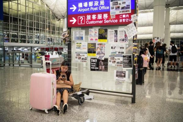 Hundreds of flights canceled at Hong Kong airport, a day after sit-in