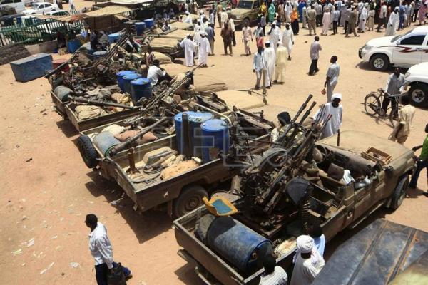 A general view over military equipment allegedly seized during a battle in the contested area of south Darfur, Nyala, Sudan, May 4, 2015. EPA-EFE FILE/Marwan Ali
