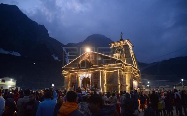 Hindu devotees convene for prayers at temple in the Himalayas