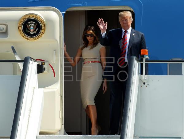 US President Donald J. Trump (R) and his wife Melania Trump walk down from their plane as they arrive at the London Stansted Airport in London, Britain, July 12, 2018. EPA-EFE/SEAN DEMPSEY