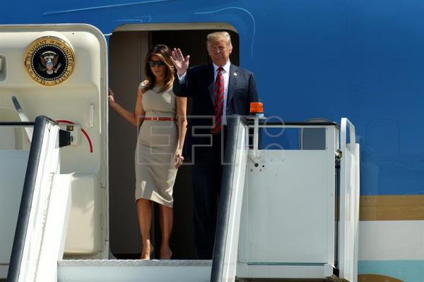 US President Donald Trump (R) and his wife Melania Trump walk down from their plane as they arrive for their first offical visit to the UK at the London Stansted Airport in Essex, United Kingdom, July 12, 2018. EPA-EFE/Sean Dempsey