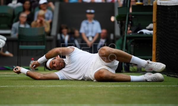 Argentina's Juan Martin Del Potro lies on the grass during his Wimbledon quarter-final match on July 11, 2018, against Spain's Rafael Nadal at the All England Club in London, United Kingdom. EPA-EFE/NEIL HALL
