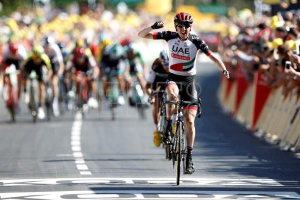 UAE Team Emirates rider Daniel Martin, of Ireland, celebrates as he crosses the finish line to win the 6th stage of the 105th Tour de France over the 181 km between Brest and Mur-de-Bretagne Guerledan, France, on July 12, 2018. EPA-EFE/YOAN VALAT