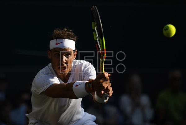 Spain's Rafael Nadal hits a backhand during his Wimbledon quarter-final match on July 11, 2018,  against Argentina's Juan Martin Del Potro at the All England Club, in London, United Kingdom. EPA-EFE/NEIL HALL