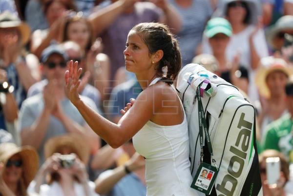 Julia Goerges of Germany walks off Centre Court following her defeat at the hands of Serena Williams of the United States in their Wimbledon semi-final match at the All England Club in London, United Kingdom, on July 12, 2018. EPA-EFE/NIC BOTHMA