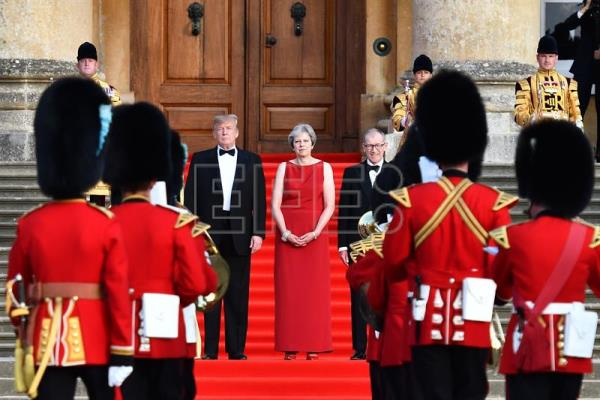 (L-R on the steps) The president of the United States, Donald Trump; the prime minister of the United Kingdom, Theresa May; and May's husband, investment relationship manager Philip May, stand on the steps in the Great Court as the bands of the Scots, Irish and Welsh Guards perform a ceremonial welcome ahead of the dignitaries' black-tie dinner with business leaders at Blenheim Palace, west of London, United Kingdom, on 12 July 2018. EPA-EFE/BEN STANSALL/POOL