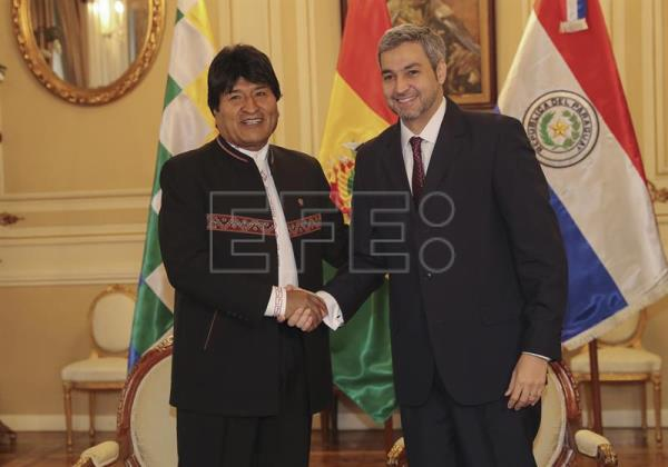 Bolivian President Evo Morales (L) and the president-elect of Paraguay, Mario Abdo Benitez, meet at the Palace of Government in La Paz, Bolivia, July 12, 2018. EPA-EFE/Martin Alipaz
