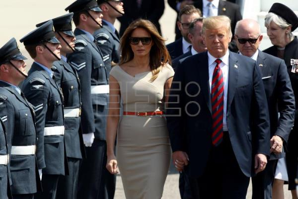 US President Donald J. Trump (R) and his wife Melania Trump arrive for their first offical visit to the UK at London Stansted Airport in Essex, Britain, July 12, 2018. EPA-EFE/SEAN DEMPSEY
