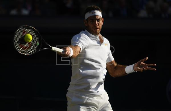 Argentina's Juan Martin Del Potro hits a forehand during his Wimbledon quarter-final match against Spain's Rafael Nadal at the All England Club in London, United Kingdom, on 11 July 2018. EPA-EFE/NEIL HALL