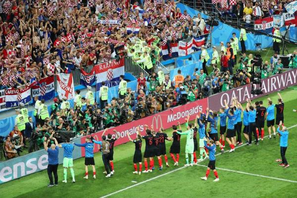 Croatian players salute their fans after defeating England 2-1 in the 2018 World Cup semifinal at Moscow's Luzhniki Stadium on Wednesday, July 11. EFE/EPA/ABEDIN TAHERKENAREH