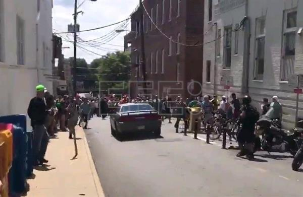 A video grab made available by Brennan Gilmore shows a car hitting a crowd in Charlottesville, Virginia, USA, 12 August 2017.  EPA/BRENNAN GILMORE/HANDOUT HANDOUT EDITORIAL USE ONLY/NO SALES