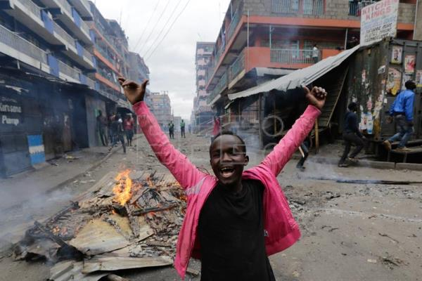 A supporter of the opposition leader Raila Odinga shouts slogans during a protest in Mathare slum, in Nairobi, Kenya, Aug. 12, 2017. EPA/DANIEL IRUNGU