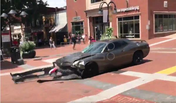 A video grab made available by Brennan Gilmore shows a car reversing after hitting a crowd in Charlottesville, Virginia, USA, 12 August 2017. EPA/BRENNAN GILMORE/HANDOUT HANDOUT EDITORIAL USE ONLY/NO SALES