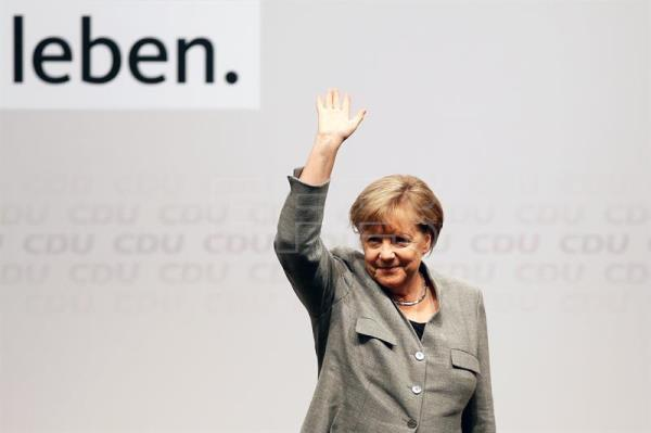 Germany's Christian Democratic Union (CDU) party chairwoman and German Chancellor Angela Merkel greets during the election campaign opening event of the German Christian Democratic Union party in Dortmund, Germany, 12 August 2017. EFE