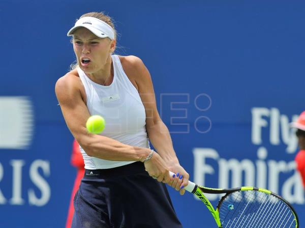 Caroline Wozniacki of Denmark in action against Sloane Stephens of the USA during the semi-finals of the Rogers Cup Women's Tennis tournament in Toronto, Canada, 12 August 2017. EFE