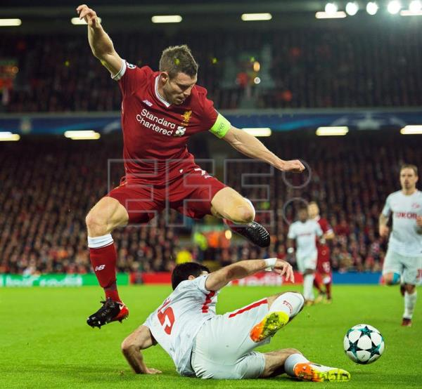 Spartak Moscow's Serdar Tasci (bottom) in action against Liverpool's James Milner (up) during the UEFA Champions League group E soccer match between Liverpool FC and Spartak Moscow at Anfield in Liverpool, Britain, Dec. 6, 2017. EPA-EFE/PETER POWELL